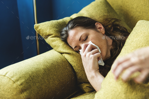 Woman sick on the sofa - Stock Photo - Images