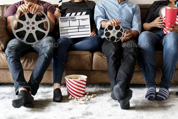 Friends watching movie together - Stock Photo - Images