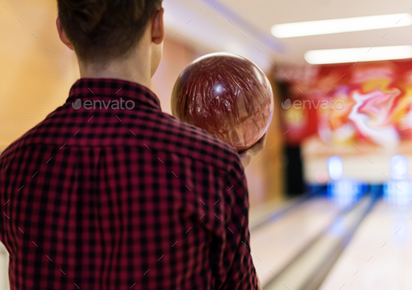 Boy carrying the bowling ball - Stock Photo - Images