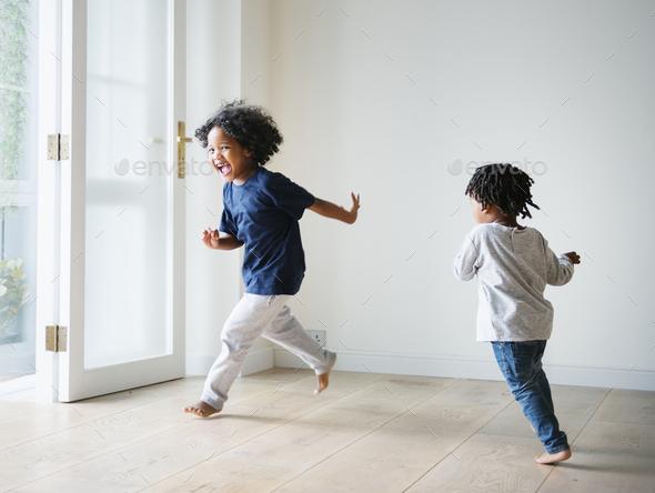 Young black boys polaying in their new house - Stock Photo - Images