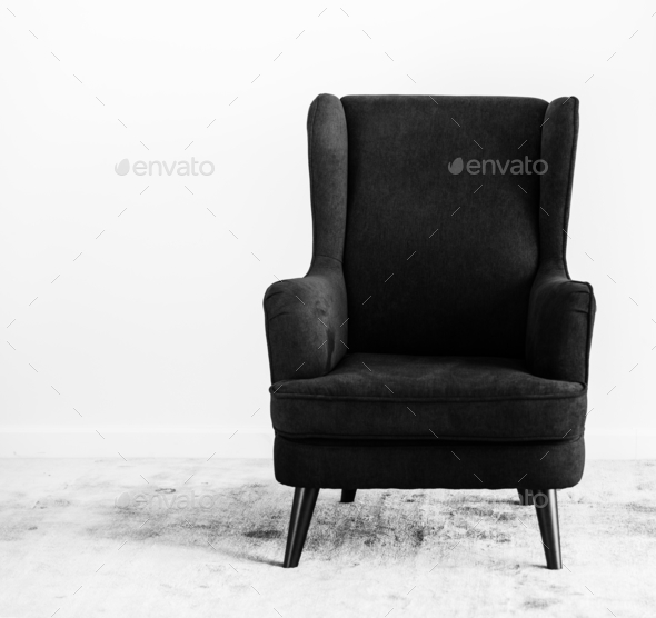 Wing back chair on a carpet no people - Stock Photo - Images