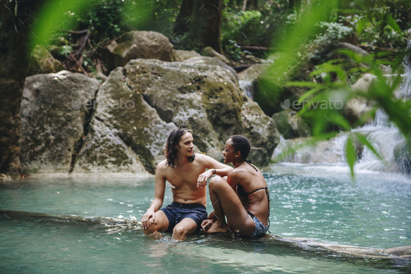 Couple enjoying the waterfall - Stock Photo - Images