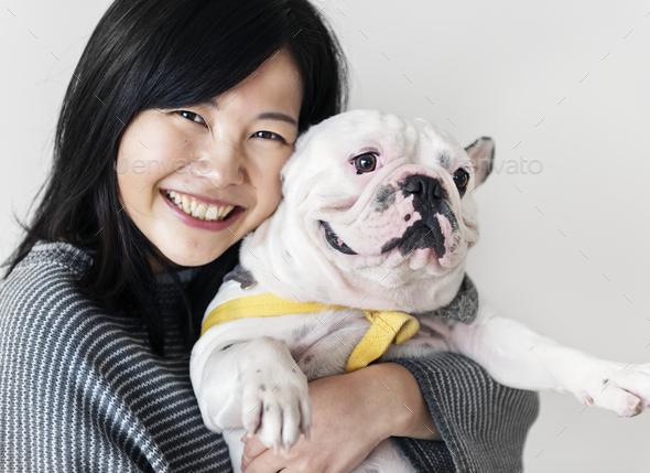 Asian woman hugging dog - Stock Photo - Images