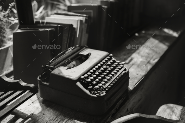 Closeup of retro typewriter on wooden table - Stock Photo - Images