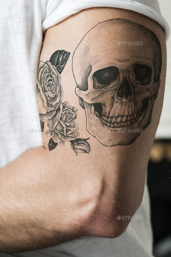 Closeup of tattoo arm of a man - Stock Photo - Images