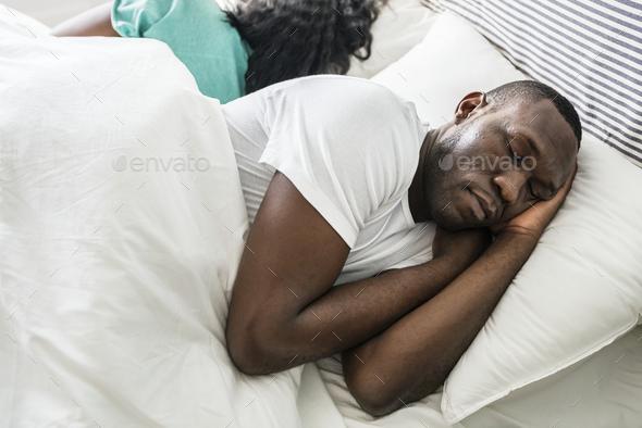 Black couple sleep together - Stock Photo - Images
