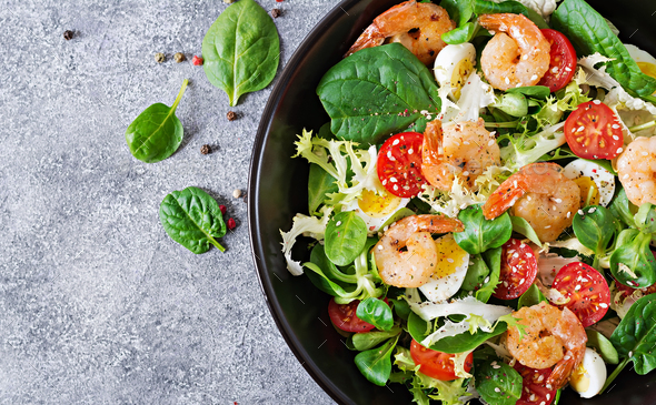 Fresh seafood recipe. Grilled shrimps and fresh vegetable salad and egg. - Stock Photo - Images