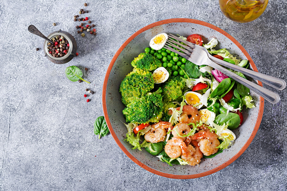 Fresh seafood recipe. Grilled shrimps and fresh vegetable salad, egg and broccoli. - Stock Photo - Images