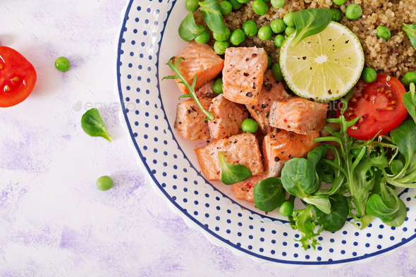 Slices of grilled salmon, quinoa, green peas, tomato, lime and lettuce leaves.  - Stock Photo - Images