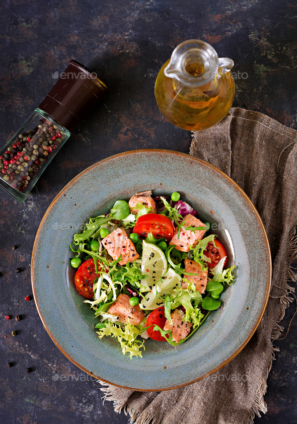Healthy salad with fish. Baked salmon, tomatoes, lime and lettuce. - Stock Photo - Images
