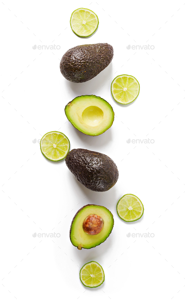 Avocado and lime isolated on white background. Top view - Stock Photo - Images