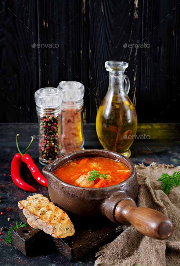 Spicy tomato soup with meatballs, pasta and vegetables.  Healthy dinner - Stock Photo - Images