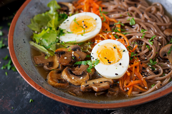Japanese miso ramen noodles with eggs, carrot and mushrooms. Soup delicious food. - Stock Photo - Images
