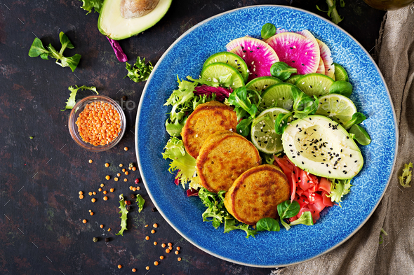 Healthy vegan lunch bowl. Fritter with lentils and radish, avocado salad. - Stock Photo - Images