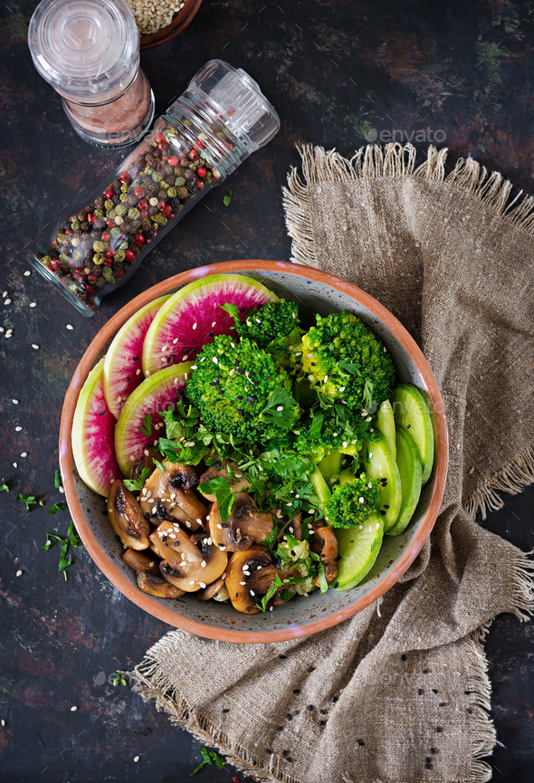 Healthy vegan lunch bowl. Grilled mushrooms, broccoli, radish salad.  - Stock Photo - Images