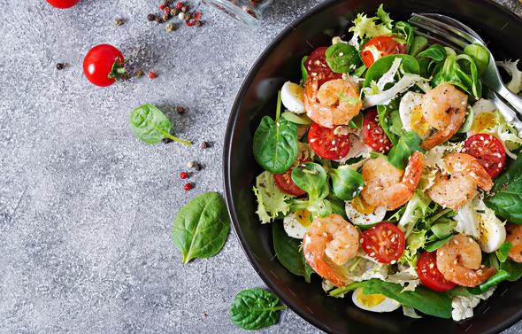 Grilled shrimps and fresh vegetable salad and egg. Grilled prawns. - Stock Photo - Images