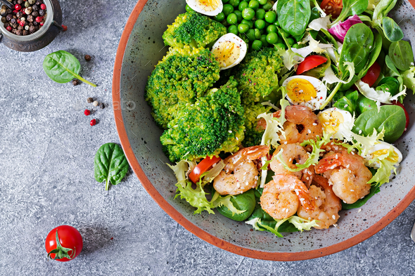 Grilled shrimps and fresh vegetable salad, egg and broccoli. Grilled prawns - Stock Photo - Images