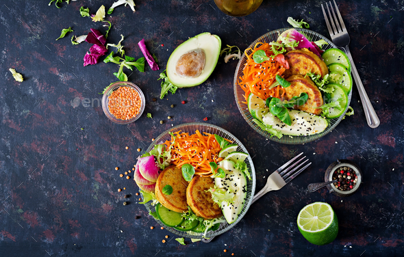 Healthy food. Healthy vegan lunch bowl. Fritter with lentils and radish, avocado, carrot salad - Stock Photo - Images