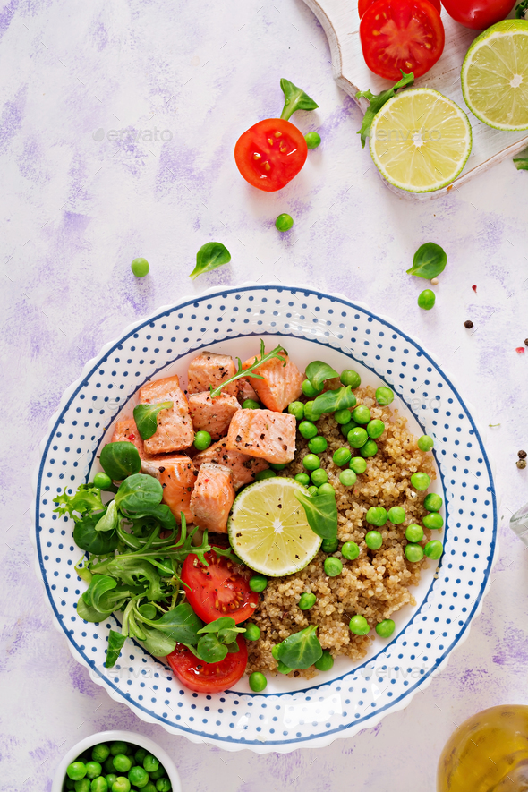 Healthy dinner. Slices of grilled salmon, quinoa, green peas, to - Stock Photo - Images