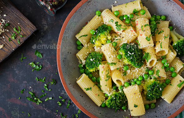 Pasta rigatoni with broccoli and green peas. Vegan menu. Dietary food. Flat lay. Top view. - Stock Photo - Images