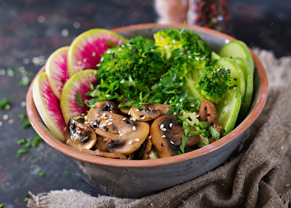 Healthy vegan lunch bowl. Grilled mushrooms, broccoli, radish salad - Stock Photo - Images