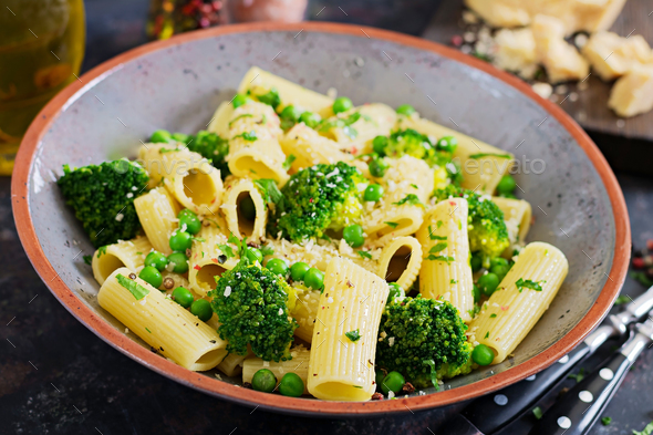 Pasta rigatoni with broccoli and green peas. Vegan menu. Dietary - Stock Photo - Images