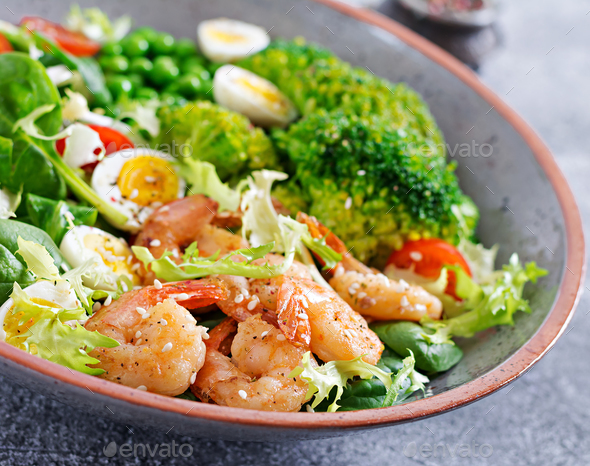 Grilled shrimps and fresh vegetable salad, egg and broccoli. Grilled prawns. - Stock Photo - Images
