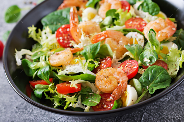 Fresh seafood recipe. Grilled shrimps and fresh vegetable salad and egg. Grilled prawns. - Stock Photo - Images