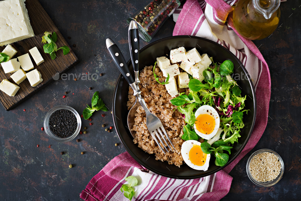 Healthy breakfast with egg, cheese, lettuce  and buckwheat porridge - Stock Photo - Images