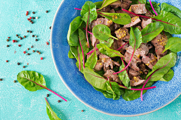 Salad of chicken liver and leaves of spinach and chard. Flat lay Top view - Stock Photo - Images