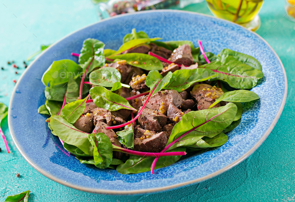 Salad of chicken liver and leaves of spinach and chard. - Stock Photo - Images