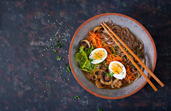 Japanese miso ramen noodles with eggs, carrot and mushrooms. Soup delicious food. Flat lay. Top view - Stock Photo - Images