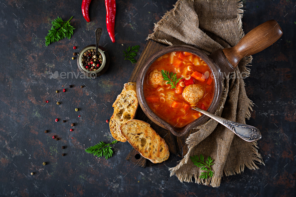 Spicy tomato soup with meatballs, pasta and vegetables.  Healthy dinner. Top view - Stock Photo - Images