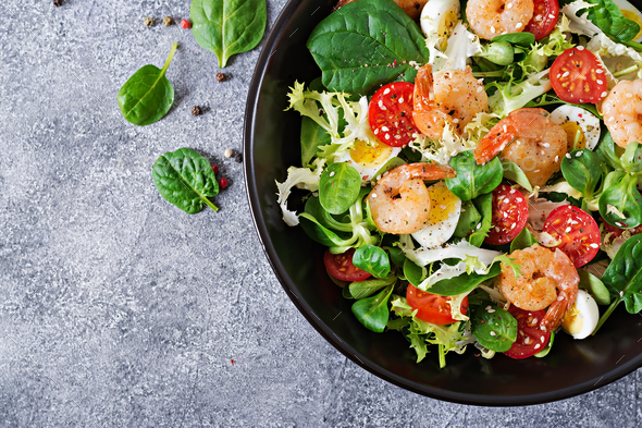 Grilled shrimps and fresh vegetable salad and egg. Grilled prawns - Stock Photo - Images