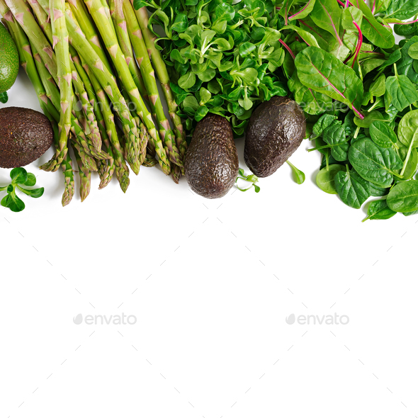 Green herbs, asparagus and black avocado on a white  background. Top view. Flat lay - Stock Photo - Images