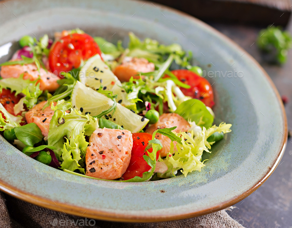 Healthy salad with fish. Baked salmon, tomatoes, lime and lettuce. Healthy dinner. - Stock Photo - Images