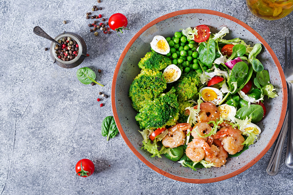 Grilled shrimps and fresh vegetable salad, egg and broccoli. Grilled prawns. Healthy food. - Stock Photo - Images