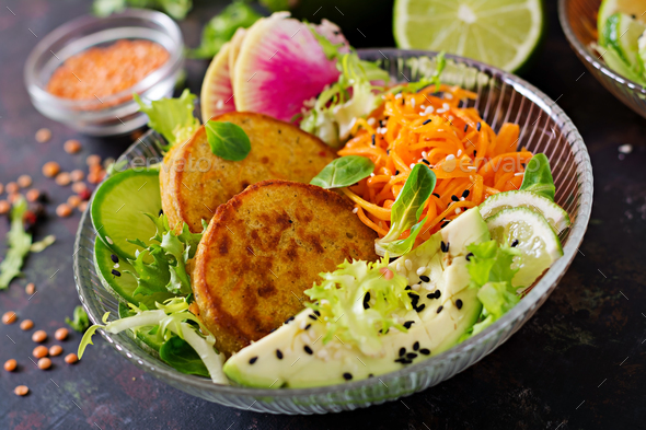 Healthy vegan lunch bowl. Fritter with lentils and radish, avocado, carrot salad. - Stock Photo - Images