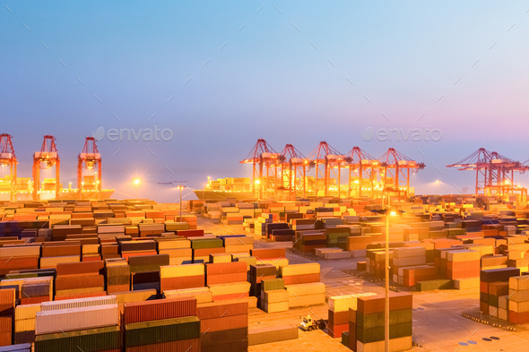 container wharf in nightfall, international import and export trade background - Stock Photo - Images