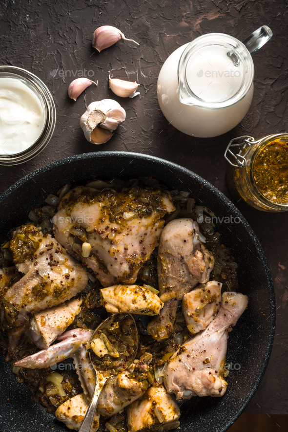 Fried pieces of chicken in a frying pan view from above. Indian food - Stock Photo - Images