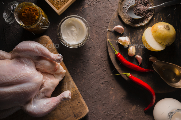 Ingredients for cooking chicken curry on the table copy space. Indian food - Stock Photo - Images