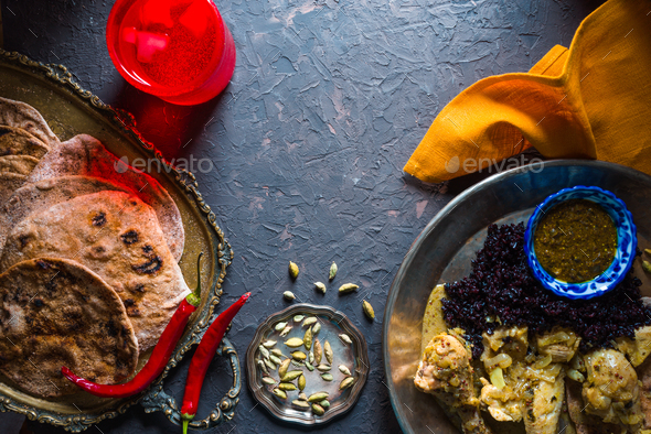 Bread of chapati, chicken curry and black rice. Indian food - Stock Photo - Images
