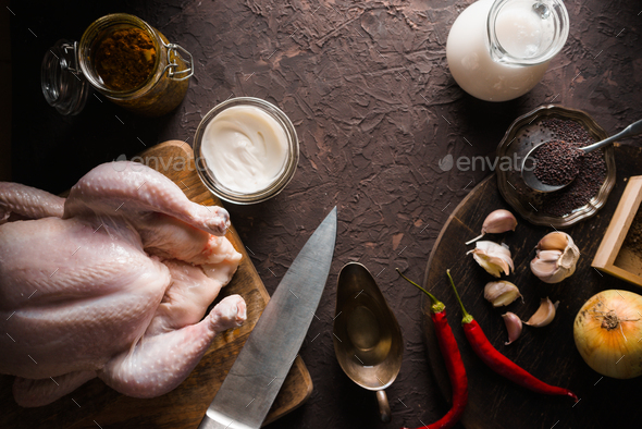 Raw chicken, curry and chili on the table - Stock Photo - Images