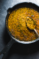Preparation of curry paste in a cast-iron frying pan closeup. Indian food - PhotoDune Item for Sale