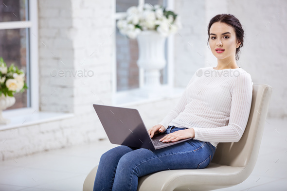 Beautiful young woman using laptop - Stock Photo - Images
