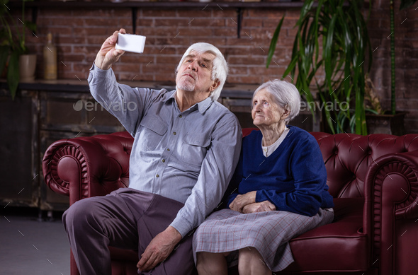 Senior couple taking selfie with smart phone  - Stock Photo - Images