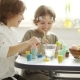 Brother and Sister Paint Easter Eggs at Home - VideoHive Item for Sale