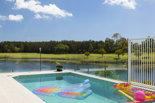 Pool overlooking golf course and canal - Stock Photo - Images
