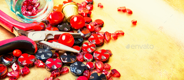 Making necklaces of glass beads. - Stock Photo - Images