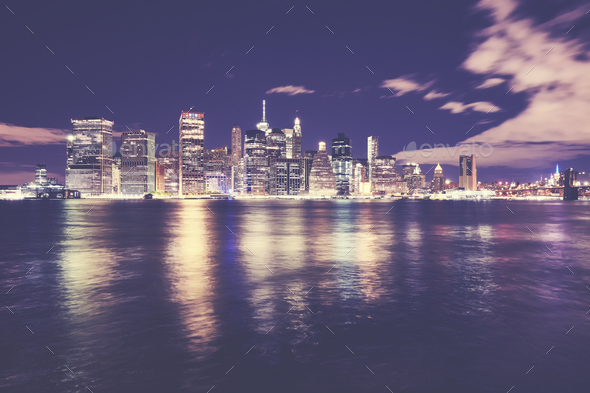 Manhattan skyline reflected in East River at night, NYC - Stock Photo - Images